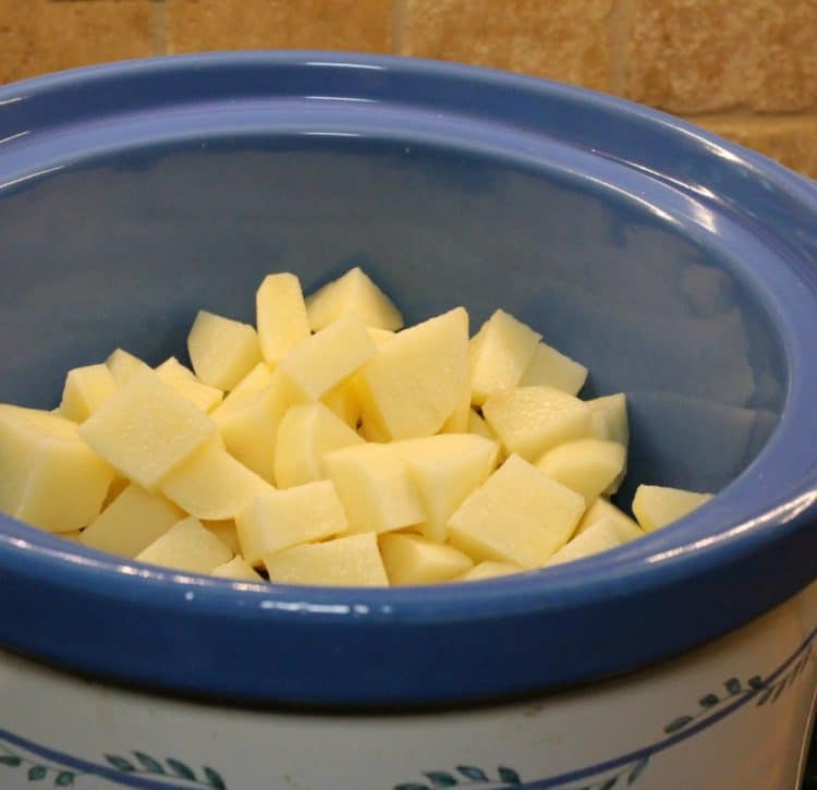 Diced potatoes ready to start slow cooking.
