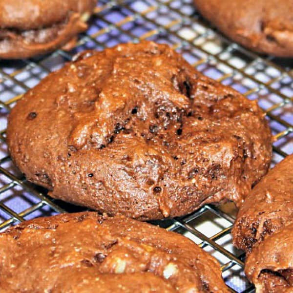 Double Chocolate Walnut Cookies are delicious fudgy cake mix cookies, chock full of chocolate chips and walnuts. Easiest one bowl recipe! #mustlovehomecooking