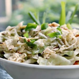 Amazing Asian Coleslaw is a crunchy blend of cabbage, ramen and onions topped with a sweet and sour sesame dressing. This flavorful salad will be a hit at any barbecue, potluck or picnic!