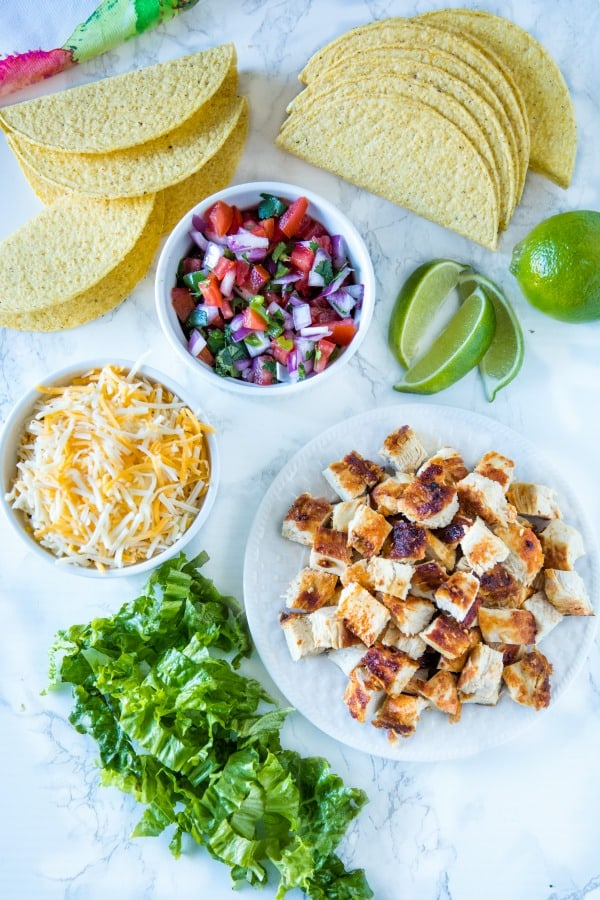 Lime Marinated Chicken Tacos are grilled, fresh lime marinated chicken breasts stuffed into crunchy taco shells and loaded with your favorite toppings. #mustlovehomecooking #mexicanfood #tacorecipes