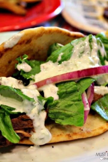 These are crazy good Gyros. Succulent marinated beef, covered in tangy tzatziki sauce and wrapped in a warm flatbread...so so good! You can make bistro quality food right in your own kitchen!!