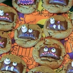 Butterfinger Ghoul Cookies are a tasty peanut butter and candy cookie treat! Cookies decorated for Halloween night, with ghoulish candy faces! Bake a batch to get the entire family in the Halloween spirit!