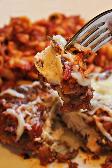 One Skillet Chicken Parmesan is moist chicken, pasta, spices and melted cheese made easy in just one pan. An easy dinner that taste's like you're in an Italian bistro!