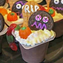 chocolate pudding cup decorated for Halloween with cookies and candies