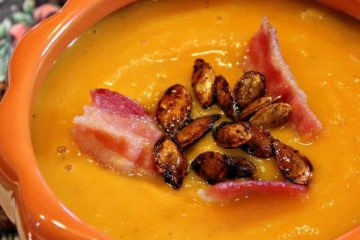 Warm and creamy, Roasted Butternut Squash Soup is comfort in a bowl. Rich oven-roasted squash, apples and onions are the base for this easy fall soup - so elegant when served in pumpkin bowls!