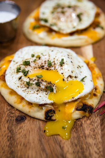 Naan Bread Breakfast Pizza with cream cheese, chives, bacon and cheese is totally delicious and an easy crowd favorite! It's ready in 10 minutes! #mustlovehomecooking