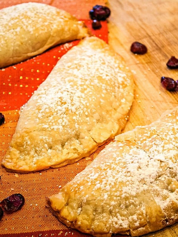 Apple Cranberry Pocket Pies are apple pie filling mixed with tart dried cranberries, baked in refrigerated pie dough.