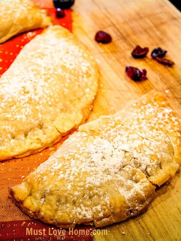 Apple Cranberry Pocket Pies - easy to make individual pies with dried cranberries and apple pie filling! Great for fall.