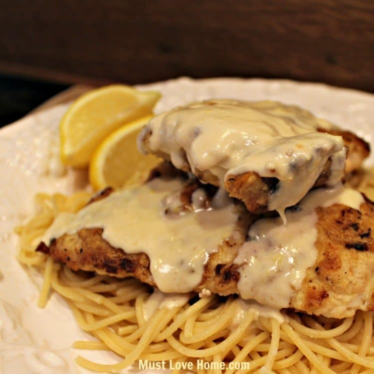 Love Lemon Chicken? Then you will love this crispy pan fried chicken breast with a smooth creamy lemon sauce! Served over pasta this dish is a delicious and filling meal! This simple recipe is perfect for the beginner cook and it will look like you spent hours in the kitchen!!