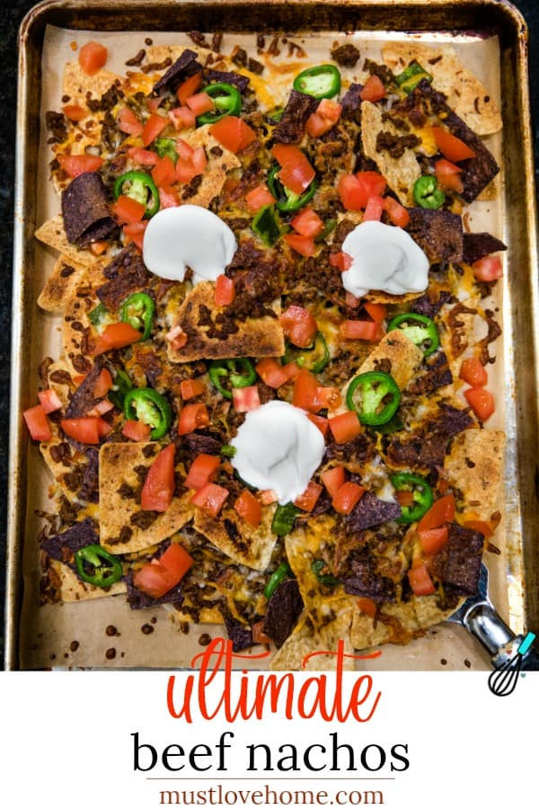 Ultimate Beef Nachos are oven crispy tortilla chips drenched in melted cheese, spicy meat and peppers. Perfect for game day, parties and a sheet pan dinner.