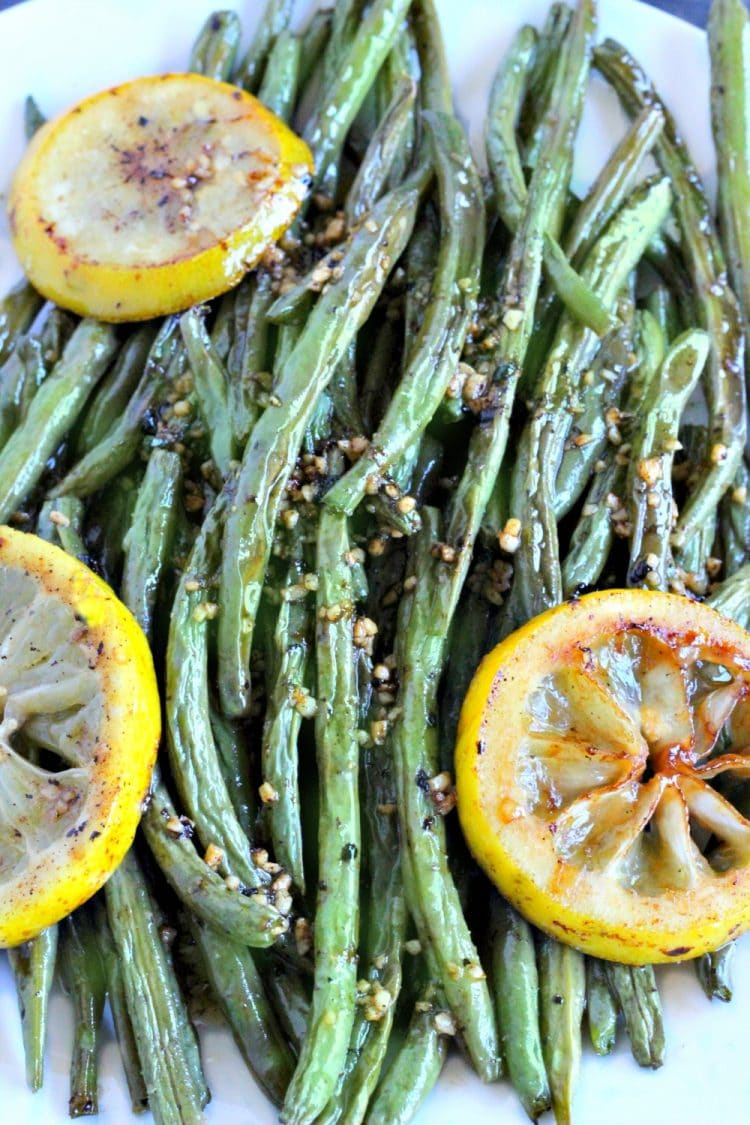Oven Roasted Green Beans are easy peasy to make. Toss on a baking pan with olive oil, salt and pepper then pop in the oven. The Green beans come out with a yummy smokey flavor that will have you roasting all of your vegetables!
