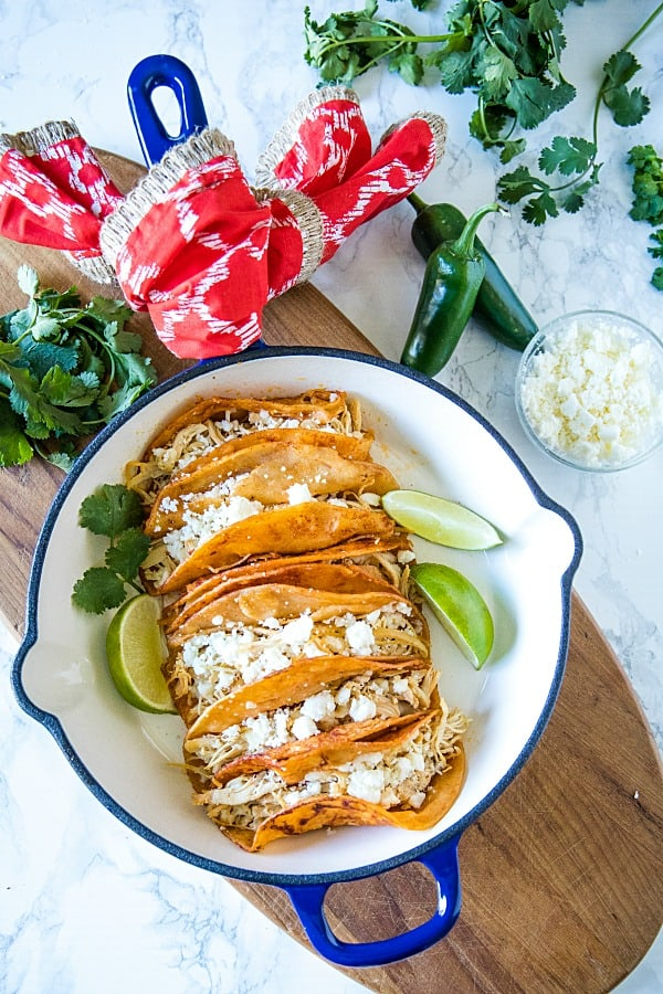 Chicken Street Enchiladas are corn tortillas dipped in thick enchilada sauce then filled with chicken and queso fresco, served folded over like a taco. Easy to make and fun to eat. #mustlovehomecooking #streetenchilada #mexicanfood