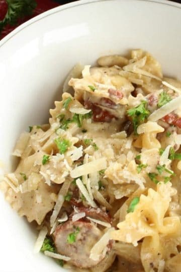 New Orleans Style Smoked Sausage Alfredo is a delicious combination of sausage, pasta, cream, parmesan cheese, Cajun seasonings and garlic. This addictive dish is super simple to make and can be on your table in less than 15 minutes.
