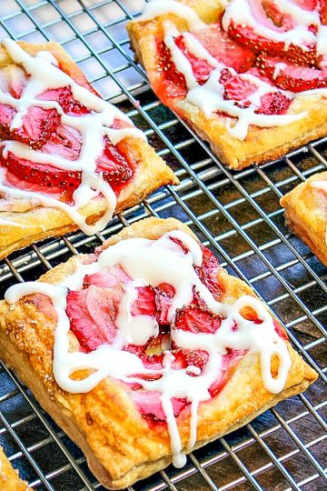 Crisp, sugar dusted puff pastry with juicy slices of strawberry baked on top.