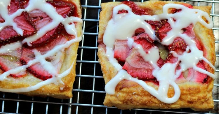 Amazing Fresh Strawberry Pastry is crisp, sugar dusted puff pastry with juicy slices of strawberry baked on top. It's like biting into a cloud of flaky crust and the best strawberry jam you have ever tasted! Easy to make in about 25 minutes - Perfect for brunch or dessert!