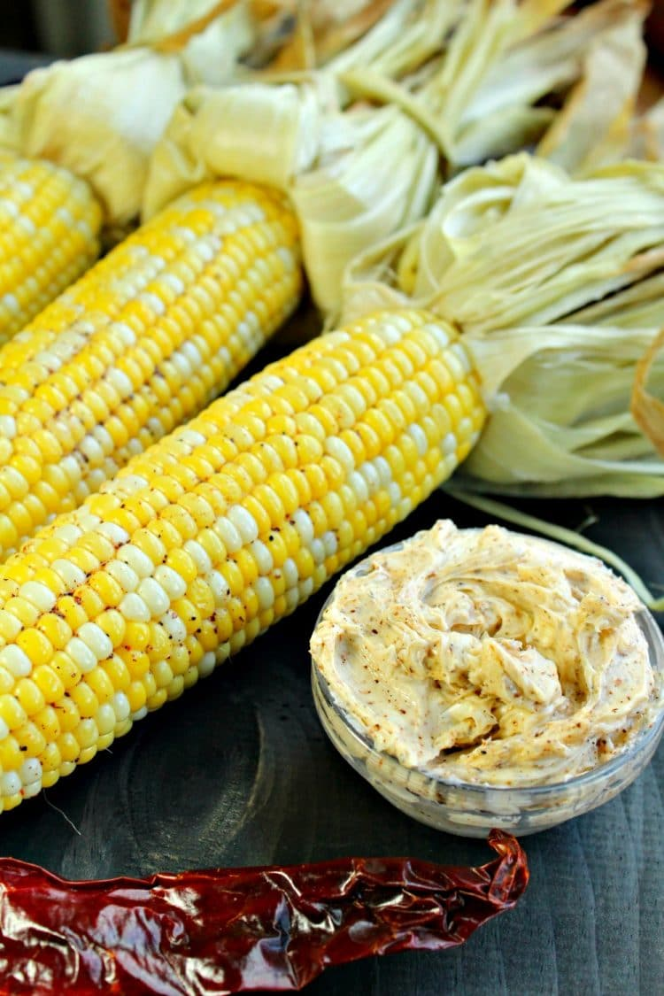Oven Cob Corn with Chili Butter is roasted cob corn steam cooked in the husk and then smeared with homemade chili butter.