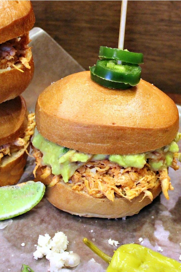 Mini Mexican Tortas are little sandwiches filled with spicy chicken, guacamole and Queso Fresco served up on a warm toasted roll.