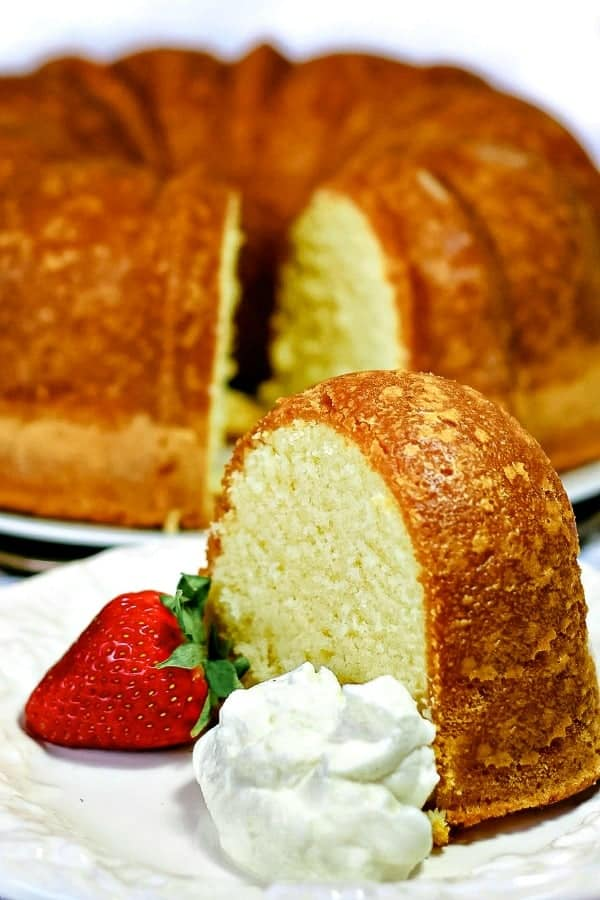 Perfect Pound Cake is buttery and sweet, with a hint of vanilla. This cake is rich, with the flavor of shortbread cookies, but still light as a feather. #mustlovehomecooking