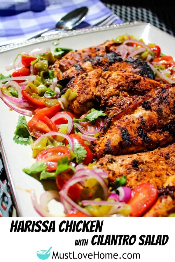 Harissa Chicken are grilled chicken breasts that have been marinated with a harissa rub of chipotle chilies, adobo sauce and spices then served with a refreshing cilantro salad.