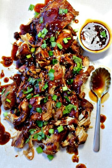 Slow Cooker Garlic Honey Chicken is tender, slow cooked chicken breasts covered in a sweet, spicy garlic sauce that will have everyone asking for seconds!