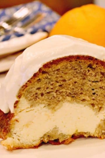 Cream Cheese Banana Bread Bundt Cake is made decadent by adding a luscious cream cheese filling - incredibly light yet so moist and delicious you will want to make it again and again!