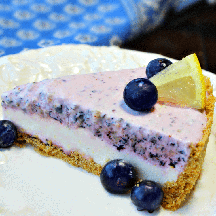 Frozen Lemon Blueberry Cheesecake Pie - a frosty treat combines cheesecake and pie into a dessert that will be a hit with the entire family!