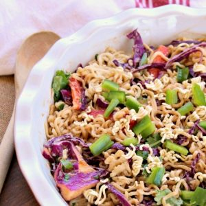 Honey Pepper Ramen Noodle Salad is a cool, crunchy mix of ramen noodles, tangy sauce, fresh peppers and cabbage. The secret is in the honey sauce - and it takes about 15 minutes! A delicious alternative to coleslaw!