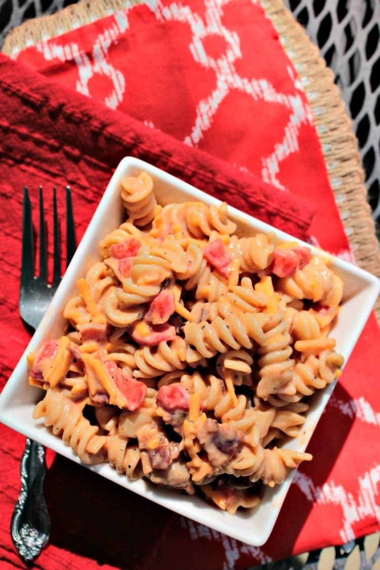 Cheddar Bacon Ranch Pasta Salad - a quick and easy combination of favorite flavors like bacon, cheddar cheese and ranch dressing tossed with pasta and BBQ sauce to create a cold side that will become your new go-to pasta salad dish! Great for picnics and potlucks too!