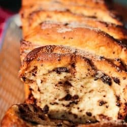 Chocolate Pumpkin Spice Pull Apart Bread is full of autumn flavors. Chocolate chips, pumpkin pie spice and frozen bread dough for an easy recipe that anyone can make.