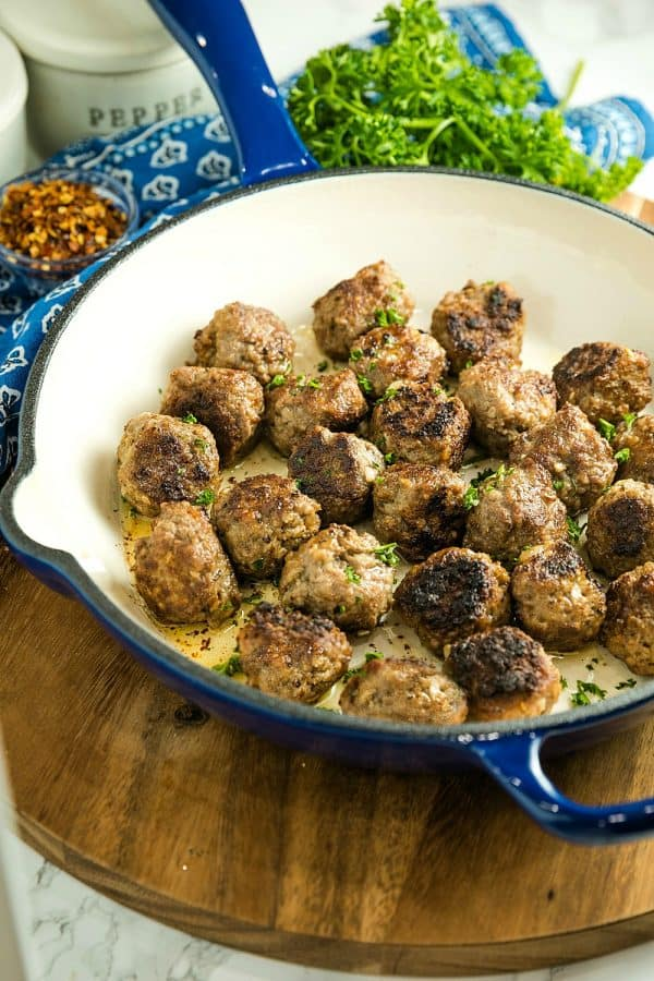Easy Skillet Meatballs are savory bites of beef, onion, caraway seeds and spices that you can add to pasta, soups or sandwiches for an easy meal. Great for making ahead and freezing. #mustlovehomecooking