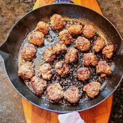 Easy Skillet Meatballs are savory bites of beef, onion, caraway seeds and spices that you can add to pasta, soups or sandwiches for an easy meal. Great for making ahead and freezing.