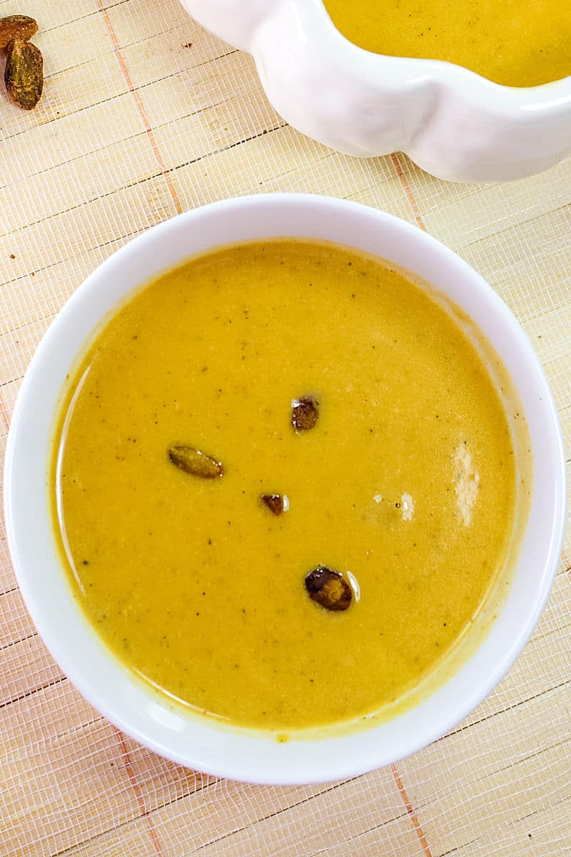 Harvest Pumpkin Soup is a creamy blend of pumpkin, broth and cream served warm with pistachios sprinkled on top