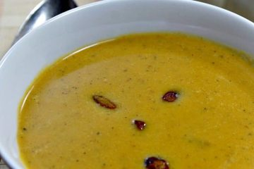 Harvest Pumpkin Soup is a creamy blend of pumpkin, broth and cream served warm with pistachios sprinkled on top. So flavorful and cozy, a hot mug of this soup will keep you warm!
