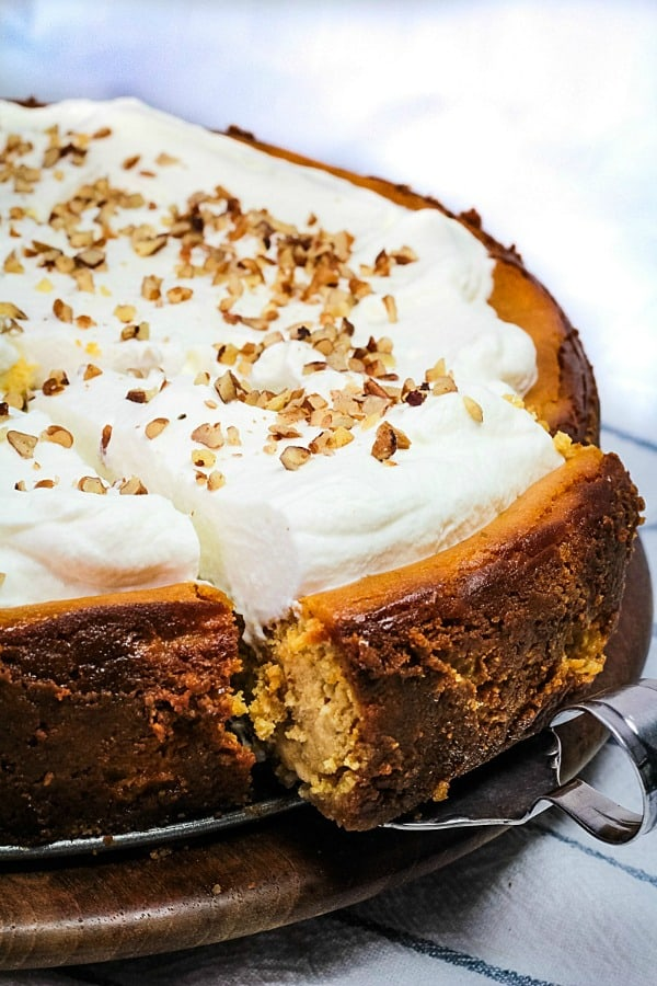 Fall parties and holidays are extra special with a rich and creamy homemade Brown Sugar Pumpkin Cheesecake.  Packed with seasonal flavor in every bite! #mustlovehomecooking