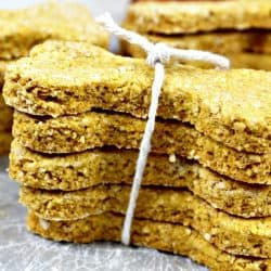 Oatmeal Pumpkin Homemade Dog Biscuits are easy to make crunchy treats that will have your best friend barking for more! Filled with wholesome ingredients like oat flour and pure pumpkin puree, you can feel good about giving them to your dog.
