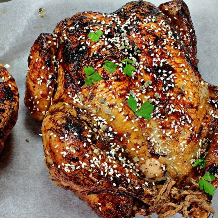 Sesame Honey Roasted Chicken is a moist, whole roasted chicken with a spiced soy and honey glaze. Finish with a dusting of toasted sesame seeds for extra crunch and flavor. This recipe makes two! Perfect to serve one now and reserve one for later.