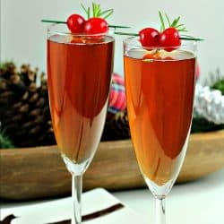 Make any occasion special with delicious Cherry Champagne Punch! Try this unique flavor combination of Cherry Liqueur and Rosemary!