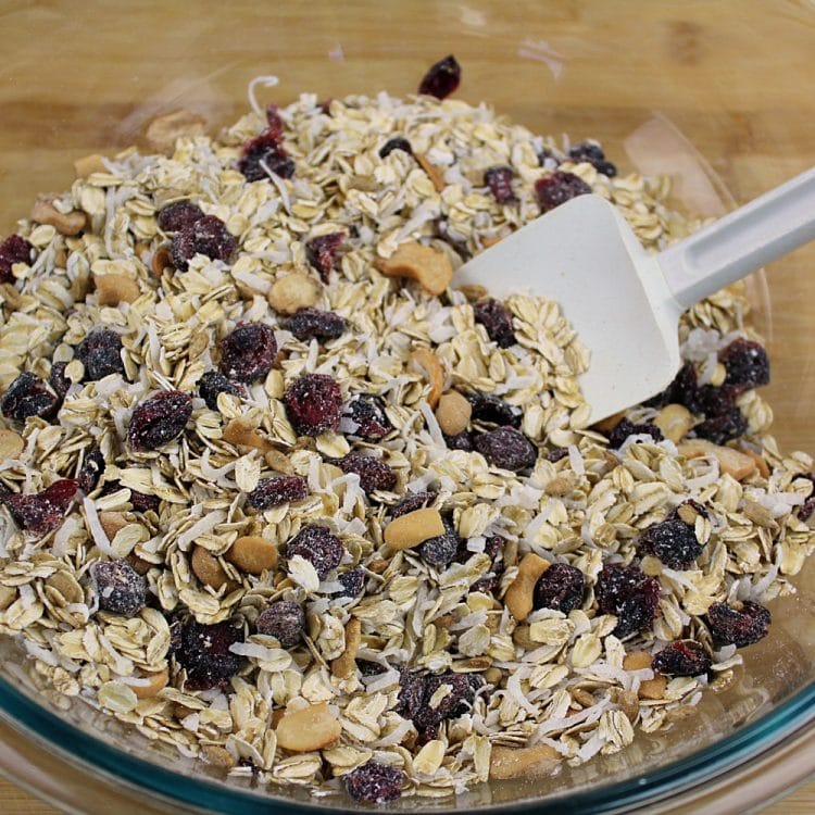 Homemade Fruit and Nut Granola could not be easier to make using this simple recipe. A healthy mix of oats, cranberries, sunflower seeds, coconut and cashews are splashed with a maple syrup mixture, then baked to crispy perfection. Great as a family-friendly breakfast and easy to customize!