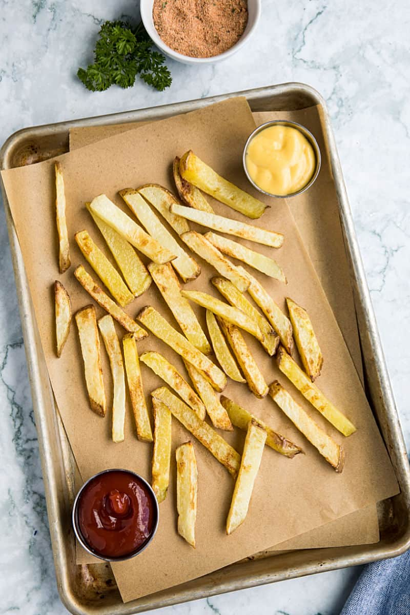 Air Fryer French Fries are a delicious way to enjoy hot and fresh fries at home. Fast and easy with little to no oil! #mustlovehomecooking