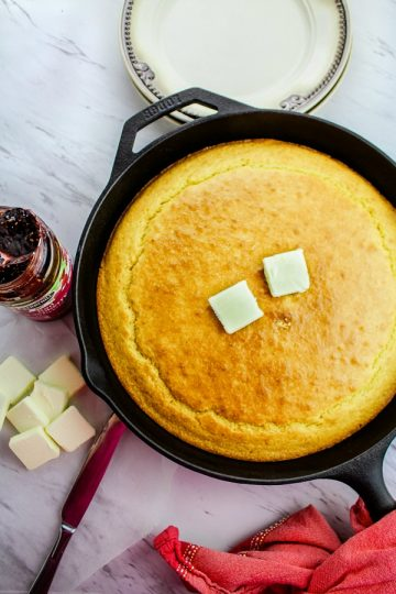 Moist and fluffy Easy Skillet Cornbread Recipe is soft on the inside with a deliciously crisp crust, this recipe is a keeper.