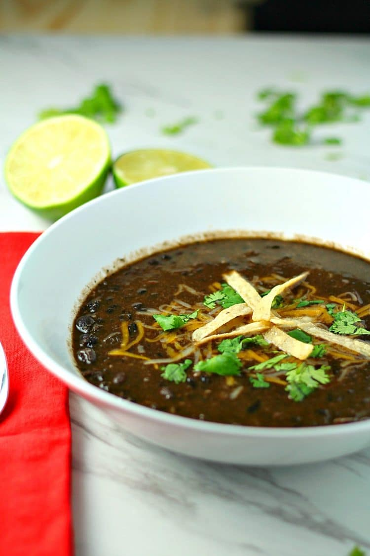 Spicy and delicious, this hearty, vegetarian Tequila Black Bean Soup takes BOLD flavor to the next level.  Loaded with Chipotle Peppers in Adobo, jalapeno peppers and real black beans, this soup is a perfect side dish for tacos, burritos and quesadillas, or it can be a meal in itself.  Make the soup even more fabulous by topping with tortilla strips, cheese, cilantro and lime wedges!