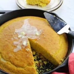 Whip up this moist and fluffy Easy Cornbread Recipe and leave your regular bread or biscuits behind. Soft on the inside with a deliciously crisp top crust, this recipe is a keeper.