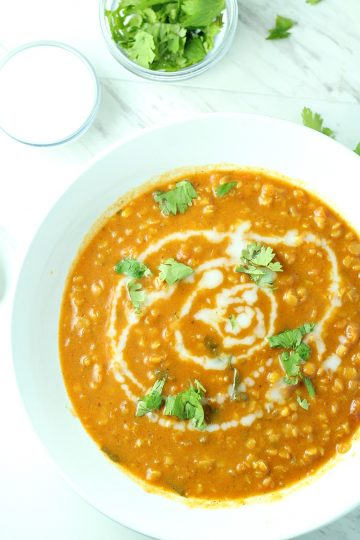 Curry Lentil and Coconut Soup with added zest from tomato, garlic, onion and ginger is a vegetarian delight! Even meat lovers are raving!