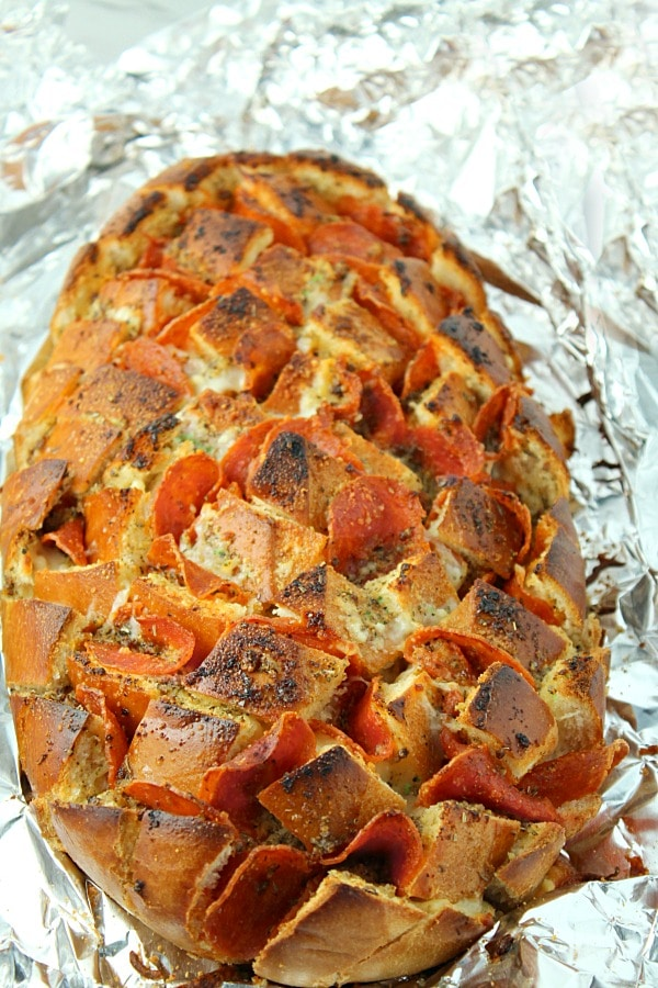 Pepperoni Pizza Pull Apart Bread is cheesy pepperoni pizza bread with a Dijon butter glaze. Easy to pull apart and dip into your favorite sauce!