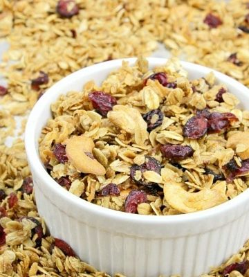 Homemade Fruit and Nut Granola could not be easier to make using this simple recipe. A healthy mix of oats, cranberries, sunflower seeds, coconut and cashews are splashed with a maple syrup mixture