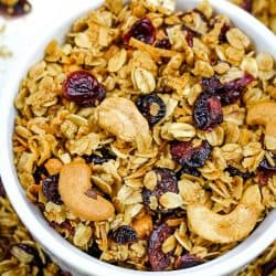 Homemade Fruit and Nut Granola is a healthy mix of oats, cranberries, sunflower seeds, coconut and cashews splashed with a maple syrup mixture, then baked to crispy perfection. Great as a family-friendly breakfast or snack and easy to customize!