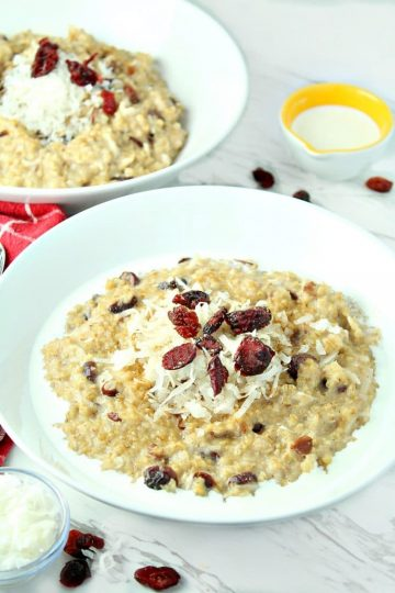 Slow Cooker Cranberry Coconut Oatmeal is made with creamy coconut milk, steel cut oats, chewy dried cranberries, brown sugar and pie spice.