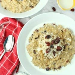 This hearty Slow Cooker Cranberry Coconut Oatmeal is made with lots of creamy coconut milk, steel cut oats, chewy dried cranberries, brown sugar and pie spice. Top off each bowlful with a handful of cranberries and coconut followed by a splash of coconut milk. A true breakfast of champions!