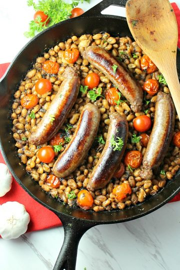 Italian Sausage Bean and Tomato Bake with crackling sausage, creamy northern beans, tomatoes and Italian seasoning can be on your dinner table in under 30 minutes!