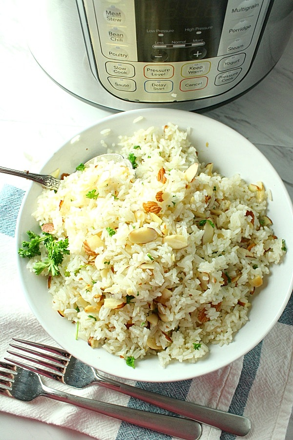 Instant Pot Almond Rice is lightly spiced, crisp and crunchy.